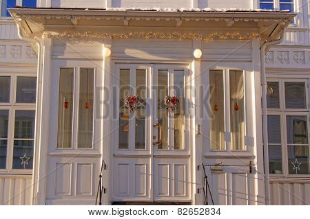 White Wooden Windows At The Entrance To The House