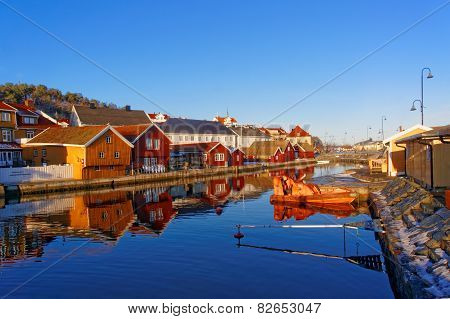 Old Colorful Buildings Reflecting In The Water