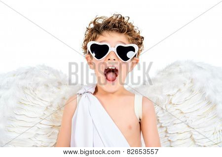 Portrait of a lovely emotional little boy in a costume of angel. Cupid. Valentine's day.