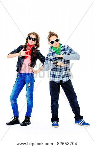 Modern teenagers posing together. Full length portrait. Studio shot.