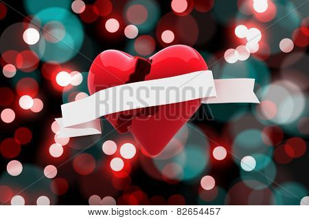 Heart with scroll against digitally generated twinkling light design