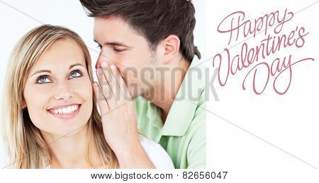 Young man whispering something to his attentive female friend against cute valentines message