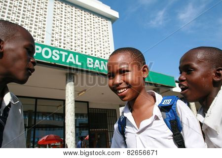 Three Black African Senior Schoolboys, Talk On The Street.