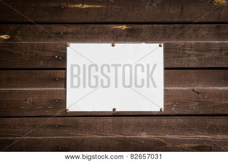 empty standard sheet on a wooden wall