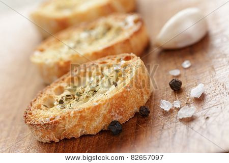 crostini with olive oil and garlic, on cutting board