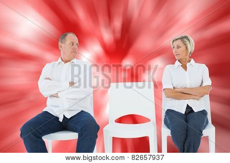 Upset couple not talking to each other after fight against digitally generated twinkling light design
