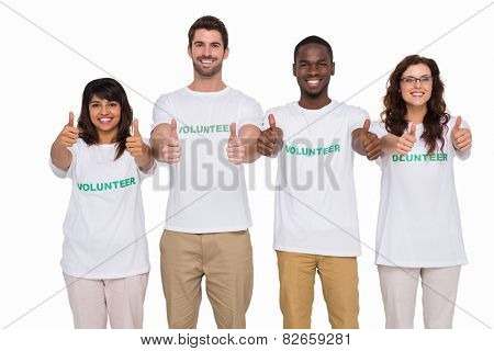 Positive teamwork smiling with thumbs up on white background