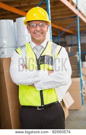 Portrait of manager wearing hard hat in the warehouse