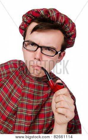 Scotsman with smoking pipe isolated on white