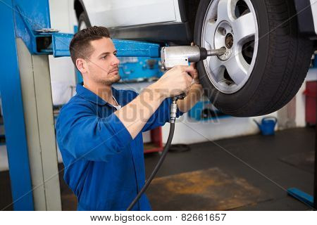 Mechanic adjusting the tire wheel at the repair garage