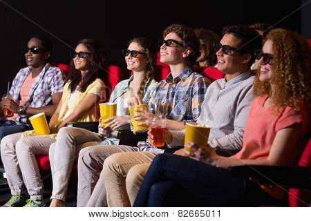 Young friends watching a 3d film at the cinema