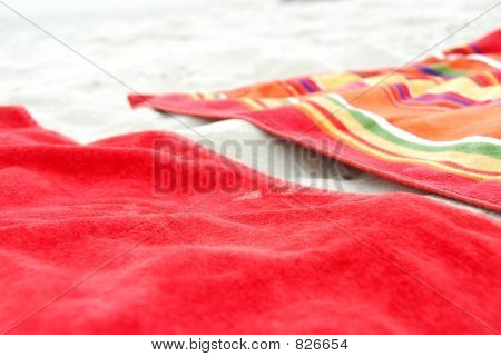 Beach towels on sand