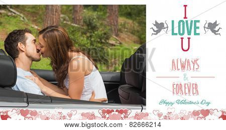 Young couple smooching on the backseat against i love you message