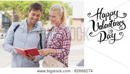Young tourist couple consulting the guide book against happy valentines day