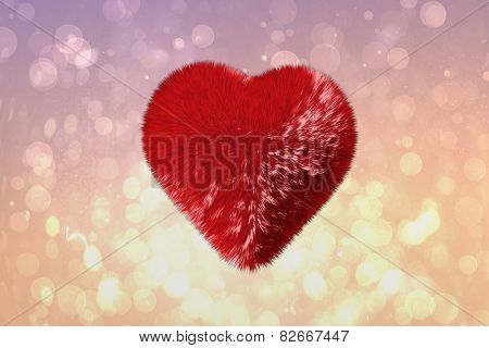 Red heart against pink abstract light spot design
