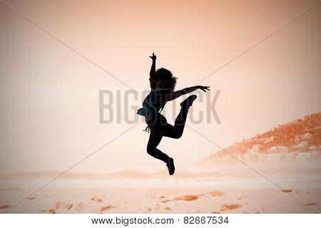 Pretty break dancer against beautiful beach and blue sky