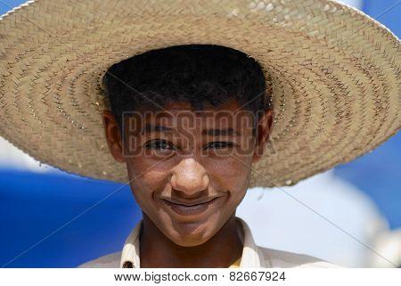 Portrait of young man wearing a straw hat in Taizz, Yemen.