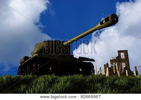 Tank and ruined house on sky background.