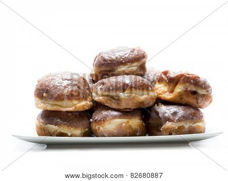 Pile of Polish donuts on plate shot on white
