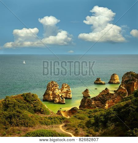 Landscape with rocks, sea and clouds.  Lagos, Portugal