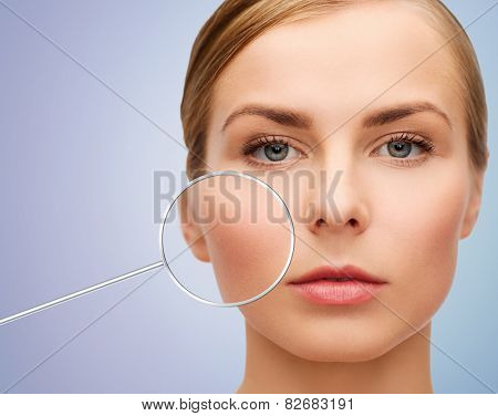 people, skin care and beauty concept - face of beautiful happy young woman over violet background