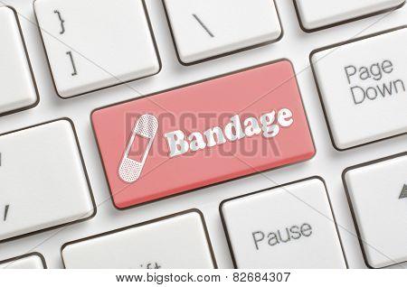 Red bandage key on keyboard