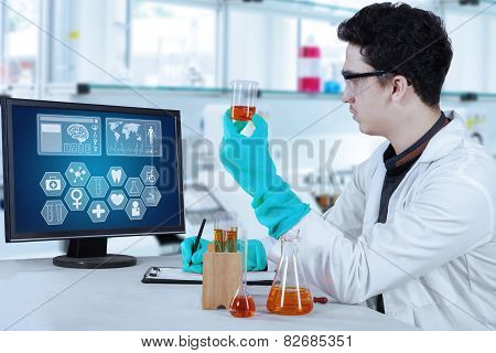 Male Scientist Work In Modern Laboratory