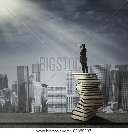 Man Standing On A Stack Of Book