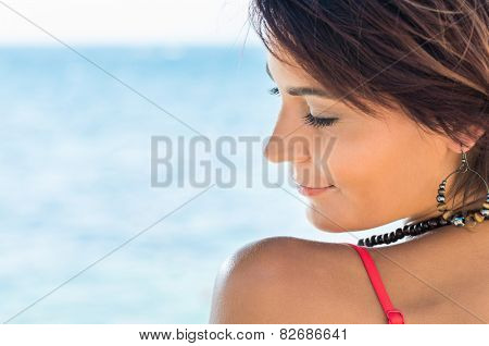 Close Up Of Beautiful Relaxed Young Woman With Eyes Closed At Seaside