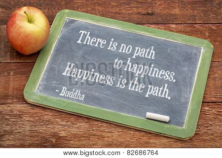 There is no path to happiness. Happiness is the path. Buddha quote  on a slate blackboard against red barn wood