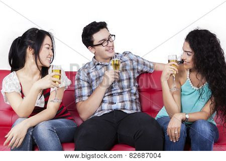 Mixed Race Teenagers Drinking Beer