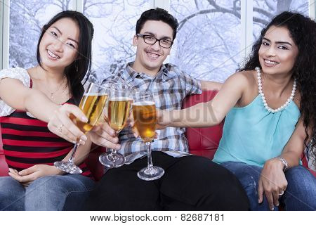 Multiracial Friends Toast With Beer