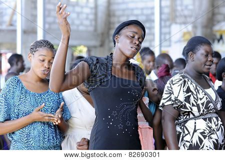 BOIS NEUS, HAITI - FEBRUARY 9, 2014:  Unidentified worshipers  in a Christian church in Bois Neus, Haiti.