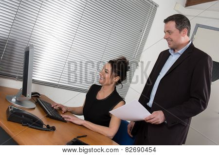 A Manager Man And His Secretary Working Together In The Office