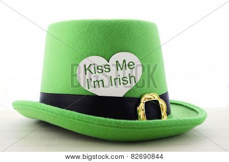 Happy St Patricks Day Green Leprechaun Hat On White Wood Table With Kiss Me I Am Irish Heart Shape G