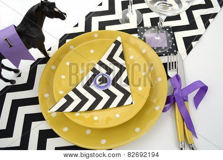 Horse Racing Carnival Event Luncheon Table Place Setting In Purple, Yellow Theme, And Black And Whit