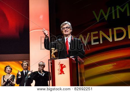 BERLIN, GERMANY - FEBRUARY 12: Wim Wenders receives the Honorary Golden Bear. 65th Berlin International Film Festival at Berlinale Palace on February 12, 2015 in Berlin, Germany