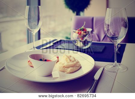 Cutlets, potato mash and vegetable salad on restaurant table, toned image