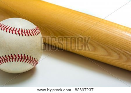Wooden baseball bat on leather ball on white background