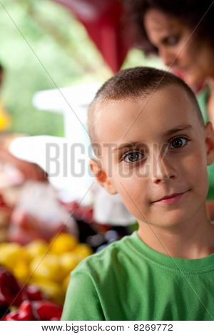 Cute Boy At The Farmer's Market