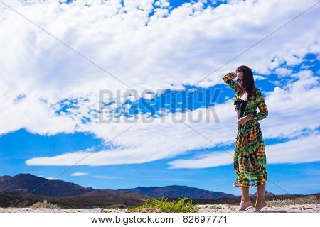 Young attractive girl on the seashore during summer vacation