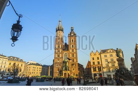 KRAKOW, POLAND - FEB 13, 2015: St.Mary's Church in historical center of Krakow on Main Square - dates to the 13th century, and at roughly 40,000 m it is the largest medieval town square in Europe.