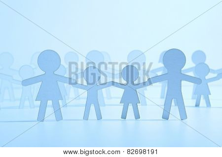 Paper family on blue background. Blue Light