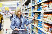 picture of supermarket  - The happy women shopping in a supermarket - JPG