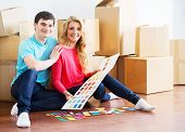 stock photo of wifes  - Young couple moving in a new home - JPG