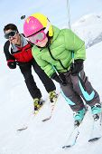 pic of daddy  - Daddy with young boy skiing down ski slope - JPG