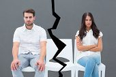 picture of not talking  - Angry couple not talking after argument against grey - JPG