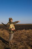 stock photo of hunter  - hunter shows you where to find birds for hunting - JPG