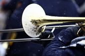 image of trombone  - Color image of a trombone being played on a snowy day - JPG