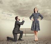 foto of forgiveness  - sad man kneeling on one knee - JPG